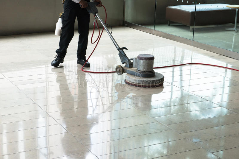building-maintenance-cleaning-floor-polishing-worker-tile-to-make-shine-clean-worker-uses-polisher-machine-to-56565158